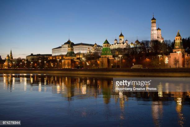 The Moskva River flows past the fortified outer walls of the Kremlin complex
