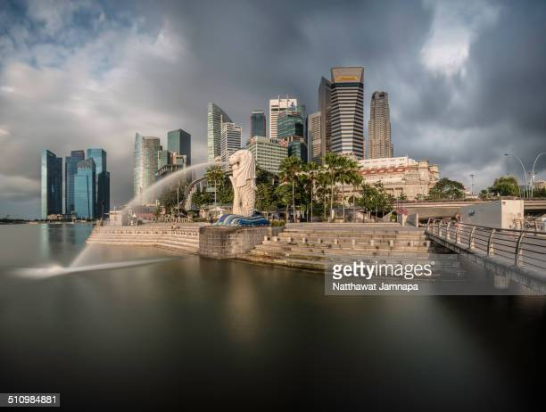 The most famous landmark in Singapore Merlion with the group of buildings behind in long exposure effect Singapore