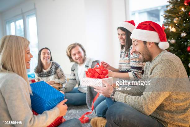 group friends sitting next to christmas