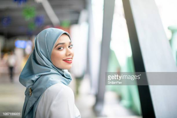 the most important thing to wear is a smile - malay hijab stock photos and pictures