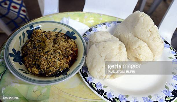 The most populal Nigerian cuisine pounded yam is served with egusi soup at a Lagos house party on November 2 2014 Pounded yam simply is a boiled...