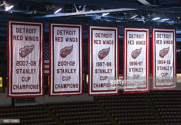 The most recent Stanley Cup banners of the Detroit Red Wings hang from the rafters before an NHL game against the Chicago Blackhawks at Joe Louis...