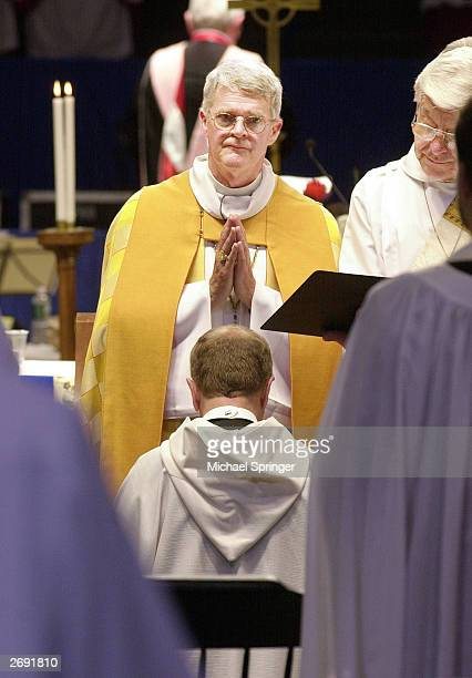 The Most Reverend Frank T Griswold III Presiding Bishop and Primate of the Episcopal Church in the United States prepares to consecrate a kneeling...
