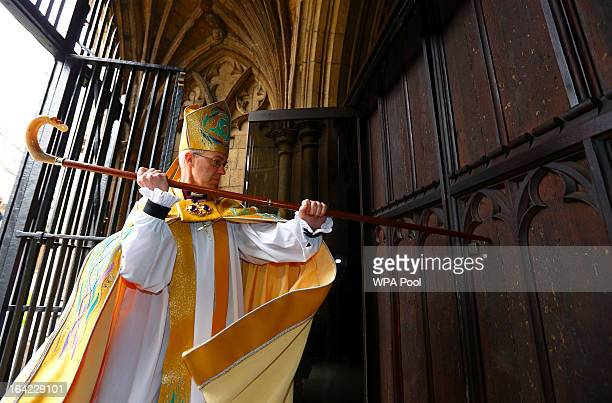The Most Reverend Justin Welby strikes three times on the West Door of Canterbury Cathedral with his pastoral staff prior to his enthronement service...