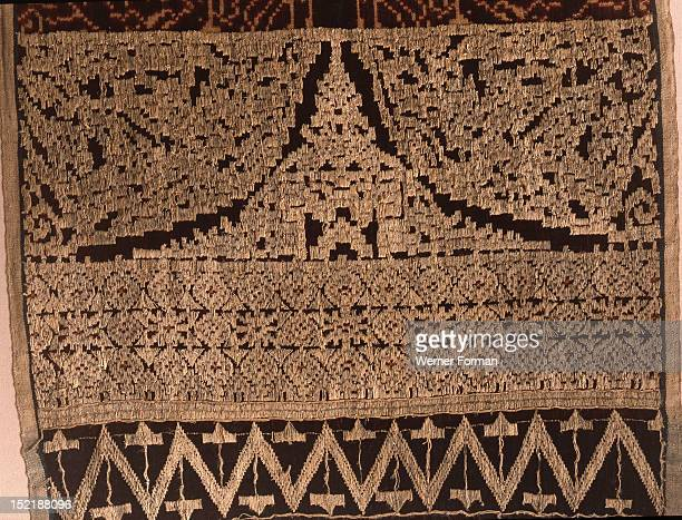 The most sacred of Balinese cloths geringsing wayang kebo are woven in only one village using a complex double ikat technique unique in Indonesia In...