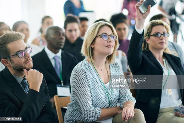 the most well attended business event on the calendar - attending stock pictures, royalty-free photos & images