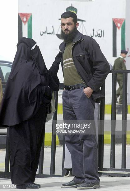 The mother and brother of Jordanian Mohammed Demes wait outside Jordan's state security court in Amman 06 April 2004 during his trial The court...