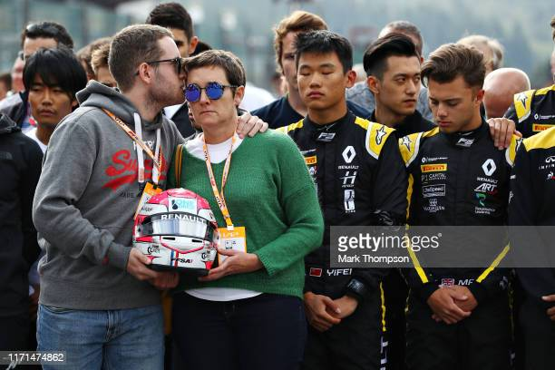 The mother and brother of the late Formula 2 driver Anthoine Hubert stand for a minutes silence on the Formula 3 grid before the F1 Grand Prix of...