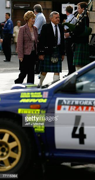 The mother and father of former World Rally champion Colin McRae who died two weeks ago arrive at a celebrtation service September 30 2007 in Lanark...