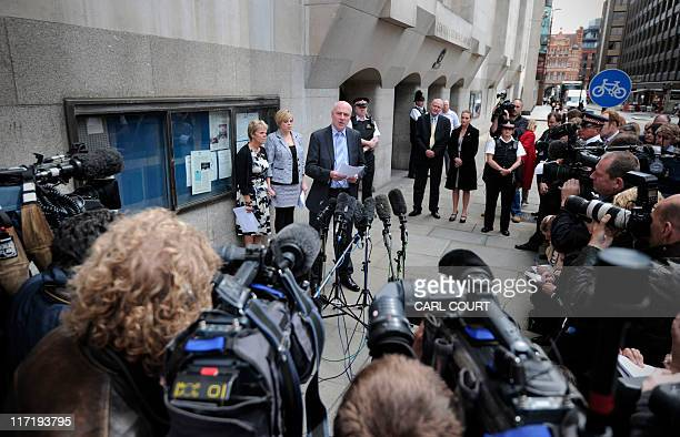 The mother and sister of murdered schoolgirl Amanda Dowler Sally and Gemma listen as father Bob Dowler reads a statement outside the Old Bailey in...