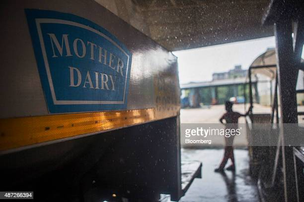 The Mother Dairy Pty logo is displayed on a delivery truck being filled with processed milk at the dock area of the company's milk plant in New Delhi...