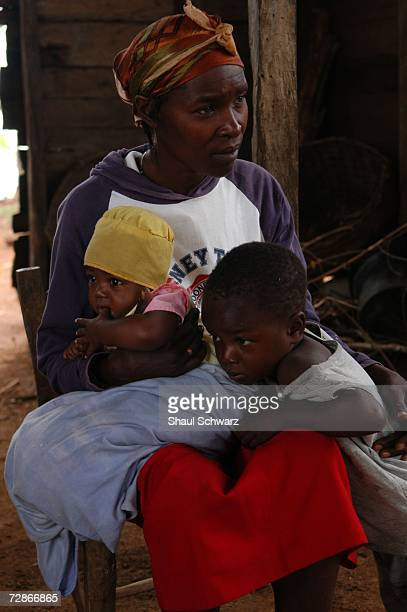 The mother of 12yearold restavek Arthemise Jean tends two of her children as she listens to social worker Pasqual describe her daughters situation on...