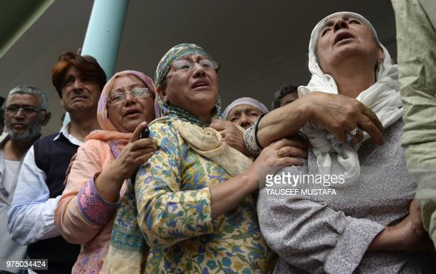 The mother of a slain editorinchief of the Srinagarbased newspaper Rising Kashmir Shujaat Bukhari mourns during the funeral procession at Kreeri some...
