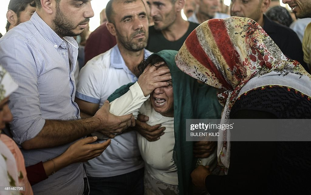 The mother of a victim cries for her son during a funeral ceremony in Gaziantep on July 21, 2015, following a suicide bomb attack the day before which killed at least 31 in the southern Turkish town of Suruc. A suspected Islamic State suicide bomber killed at least 31 people in an attack on a Turkish cultural centre in the southern town of Suruc, where activists had gathered to prepare for an aid mission in the nearby Syrian town of Kobane. It was one of the deadliest attacks in Turkey in recent years and the first time the government has directly accused the IS group of carrying out an act of terror on Turkish soil.
