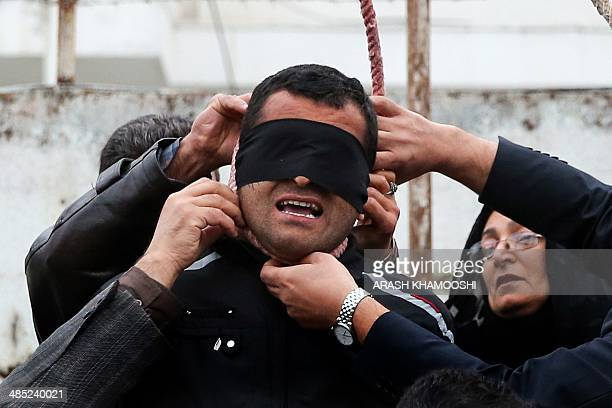 The mother of Abdolah Hosseinzadeh who was murdered in 2007 removes the noose with the help of her husband from around the neck of Balal who killed...