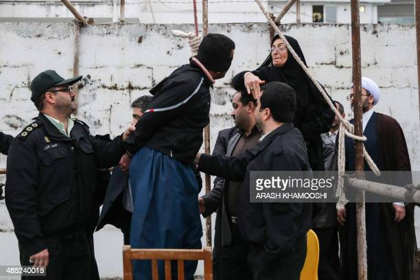 The mother of Abdolah Hosseinzadeh who was murdered in 2007 slaps Balal who killed her son during the execution ceremony in the northern city of Noor...