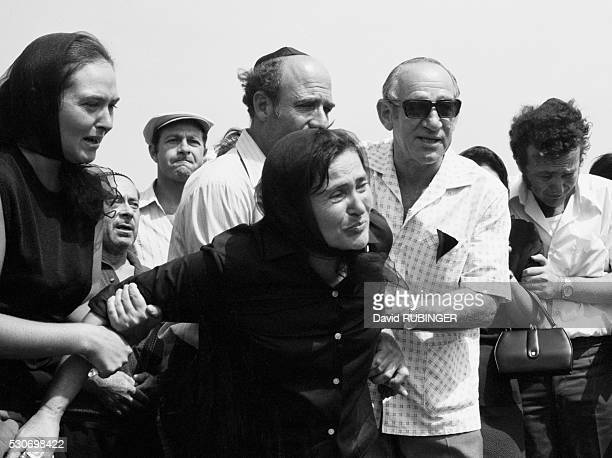 The mother of an Israeli athlete slain at the 1972 Summer Olympic Games grieves for her son at his funeral. It was the first year the modern state of...