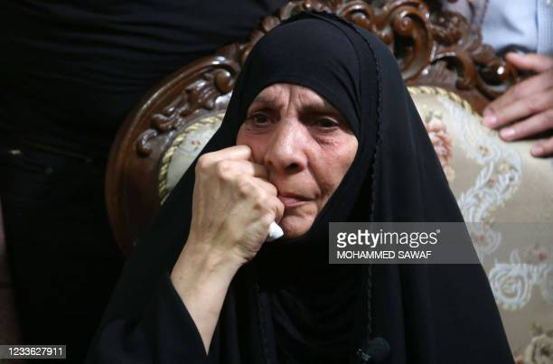The mother of assassinated Iraqi activist Ihab Jawad al-Wazni reacts during the visit of Special Representative of the Secretary-General for the...