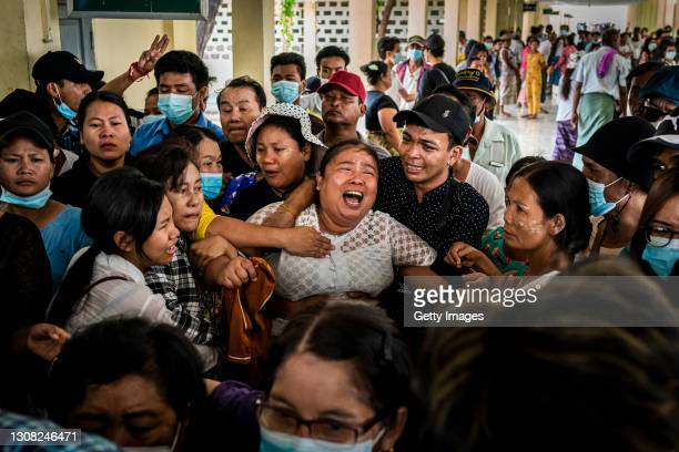 The mother of Aung Kaung Htet wails while mourning during a funeral for Aung who was killed when military junta forces opened fire on anti-coup...