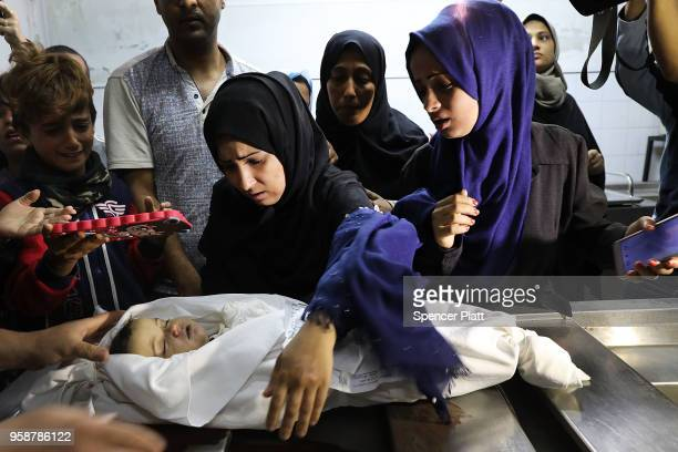 The mother of eightmonthold Leila Anwar Ghandoor who died in the hospital on Tuesday morning from tear gas inhalation looks at her daughter as she is...