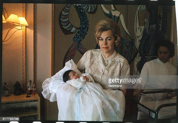 The mother of Empress Farah Diba holds Princess Farahnaz the new daughter of the Empress and Shah Mohammed Reza Pahlavi