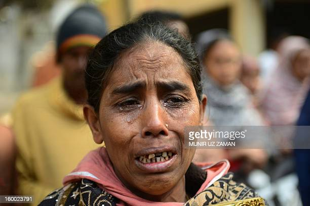 The mother of factory fire victim, Fathema Ahenur weeps during a protest demanding punishment for the Tazreen Fashion factory owner and compensation...