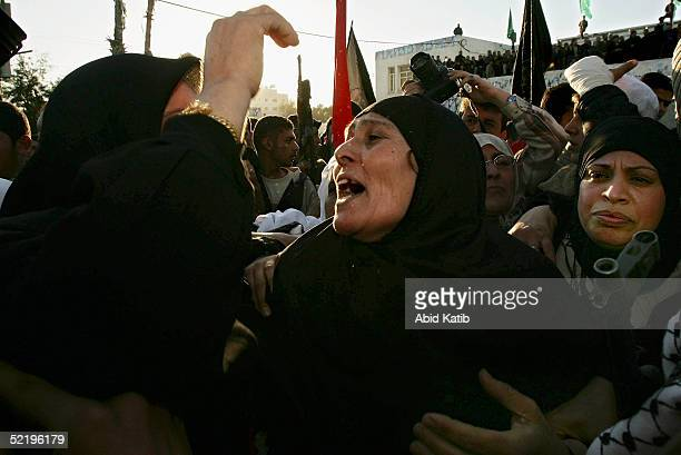 The mother of fighter Yousif Omar screams as his body one of 15 palestinian bodies arrives at the Palestinian parlement park after being returned by...