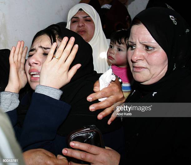 The mother of fivemonth old Mohammad Naser AlBuri mourns during his funeral February 28 2008 in Gaza City Gaza AlBuri who is the son of the UNRWA of...