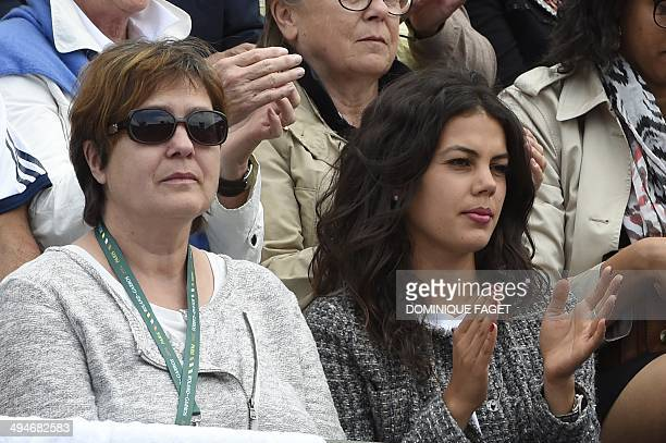 The mother of France's JoWilfried Tsonga Evelyne and his girlfriend Noura attend the French tennis Open third round match against between Tsonga and...