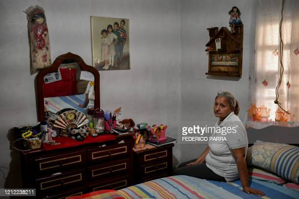 The mother of Geovanny Lopez, who disappeared in a shipwreck en route from Venezuela to Trinidad and Tobago on May 16 poses for a picture during an...