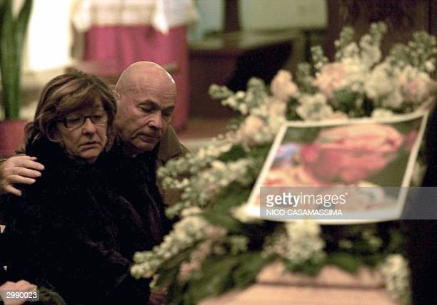 The mother of Italian cyclist Marco Pantani, Tonina, cries next to husband Paolo as they pay their respect to their son in Cesenatico's church, on...