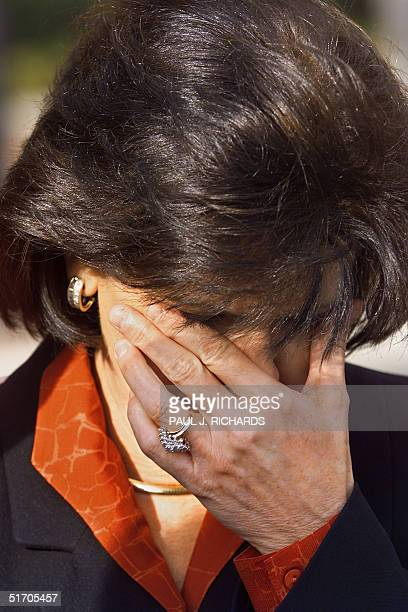 The mother of killedinaction in Afghanistan CIA agent Mike Spann Gail Spann weeps as Spann's father John delivers a statement to the media outside...