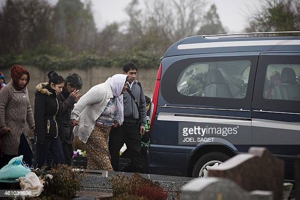 The mother of late Maria Francesca cries flanked by relatives during the funeral of her baby on January 5 2015 at the Wissous cemetery Christian...