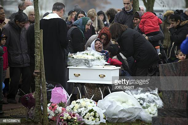 The mother of late Maria Francesca cries in front of the coffin of her baby during her funeral on January 5 2015 at the Wissous cemetery Christian...