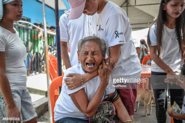 The mother of Leover Miranda who was killed by police in an antiillegal drugs operation weeps during his Manila Philippines August 20 2017 On...