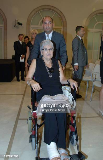The mother of Manchester City's coach Pep Guardiola Dolors Sala in a wheelchair with her son Pere on the day Pep was awarded with the Golden Medal of...