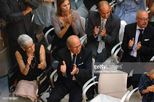 The mother of Manchester City's coach Pep Guardiola Dolors Sala in a wheelchair sits next to her son Pere on the day Pep was awarded with the Golden...