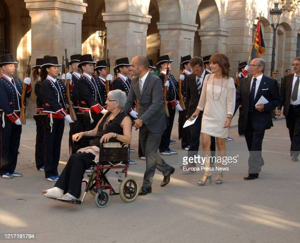 The mother of Manchester City's coach Pep Guardiola Dolors Salain a wheelchair with her son Pere on the day Pep was awarded with the Golden Medal of...