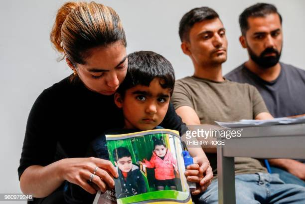 The mother of Mawda Shawri a twoyearold girl of Kurdish origin who died after police gave chase to a van carrying illegal migrants in Belgium shows a...