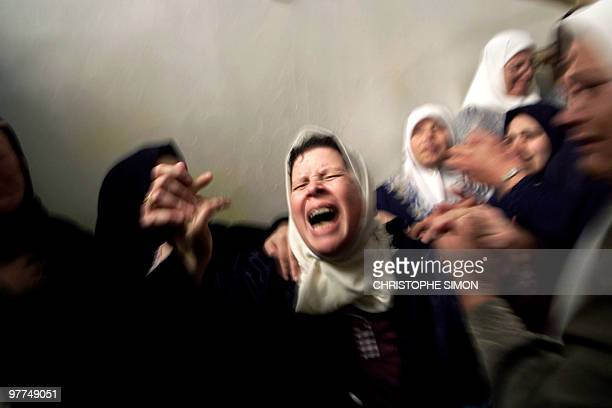 The mother of Mohammed alMadhun killed yesterday by Israeli gunfire near the Jewish settlement bloc of Gush Katif wails during her son's funeral in...