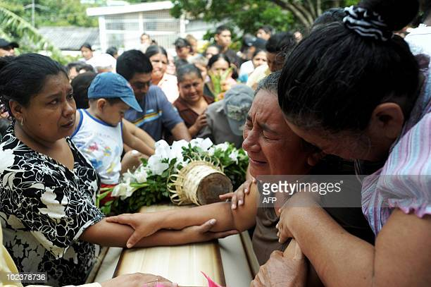 The mother of Nohemy Elizabeth Cruz cries during her burial on june 24 on June 24 2010 in Mejicanos a suburb of San SalvadorCruz was killed with 13...