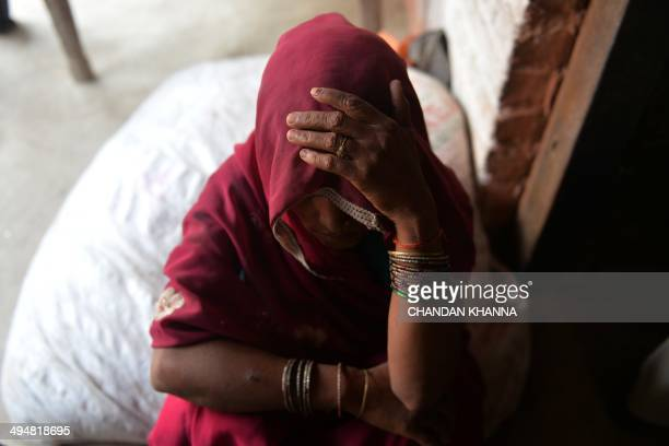 The mother of one of the gangrape victims looks on at Katra Shahadatgunj in Badaun India's Uttar Pradesh state on May 31 2014 Two minor girls were...