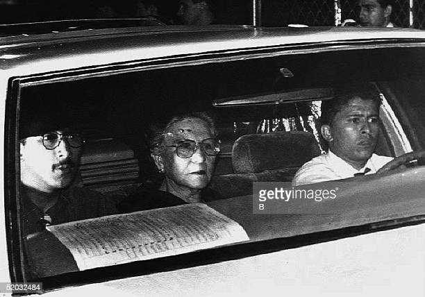 The mother of Pablo Escobar Mermilda Gaviria rides in a car taking Escobar's casket to a funeral home 02 December 1993 from the local coroners office...
