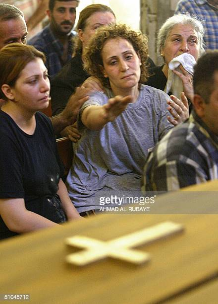 The mother of Rami Saad and Sami Saad grieves during the funeral of her two children who died the day before in a mortar attack that hit their house...