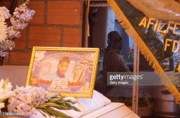 The mother of Rudy Cristian Vásquez is reflected on a window during the funeral ceremony of her son who was killed during clashes with police at the...