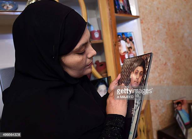 The mother of slain Pakistani school student Asfand Khan who was killed during an attack by Taliban militants at an army public school looks at his...