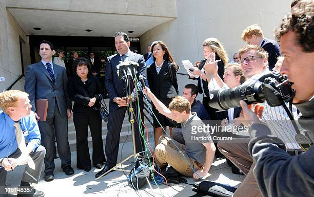 The mother of slain Yale University student Annie Le Vivian Le third from left stands beside her attorney Joe Tacopina at the microphone after her...