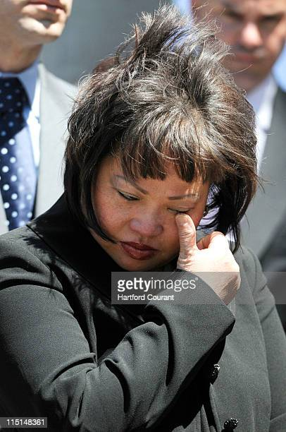 The mother of slain Yale University student Annie Le Vivian Le wipes a tear away as her attorney Joe Tacopina not shown speaks to the media Friday...