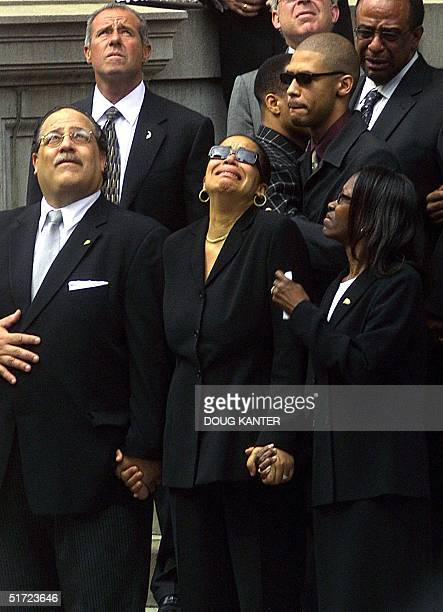 The mother of the late RB star Aaliyah Diane Haughton cries as she watches doves fly away after being released in front of the St Ignatius Loyola...