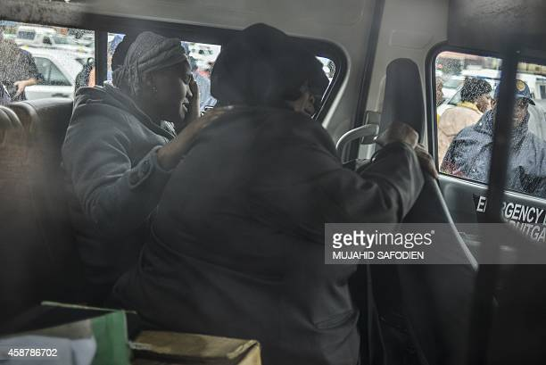 The mother of the suspect accused of Bafana Bafana captain Senzo Meyiwa'murder leaves the Boksburg magistrate court after a prebail hearing on...